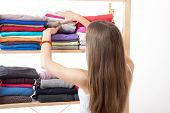 picture of wardrobe  - Young caucasian woman standing near the wardrobe - JPG