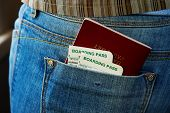 pic of boarding pass  - Passport and air boarding passes in jeans pocket - JPG