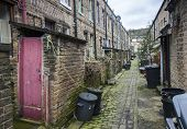 stock photo of outhouses  - outhouses on a cobbled back street in Hebden Bridge Halifax