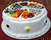 stock photo of ice-cake  - A traditional birthday cake decorated with assorted candy - JPG