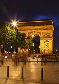 stock photo of charles de gaulle  - Tourists and Parisians are passing by in front of Arc De Triomphe - JPG