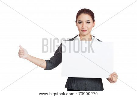 Asian Businesswoman Hold A Blank Sign And Hitchhiking