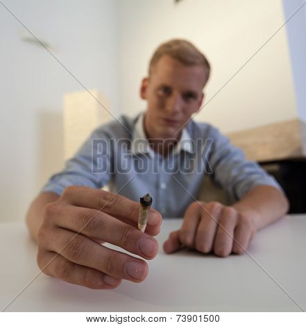 Man Holds In His Hand A Joint