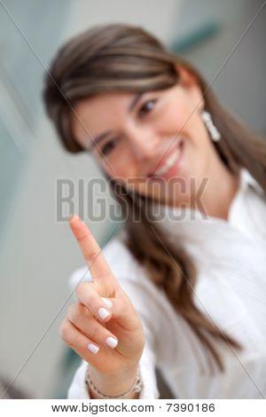 Woman Pushing A Button