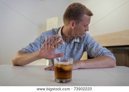 Man Refuses To Drink A Glass Of Whiskey