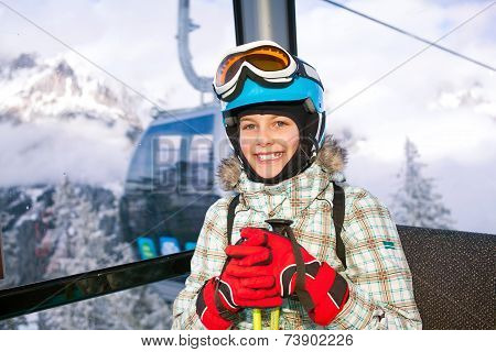 Happy skier girl on ski lift.