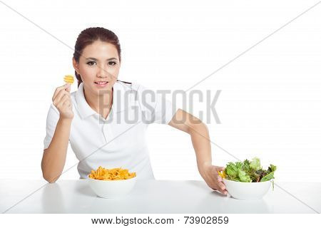 Asian Girl Smile For  Crisps Push Away  Salad