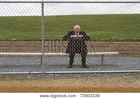 Businessman Sitting on Sidelines