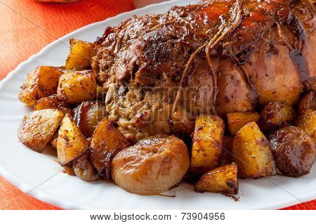Roast with backed potatoes
