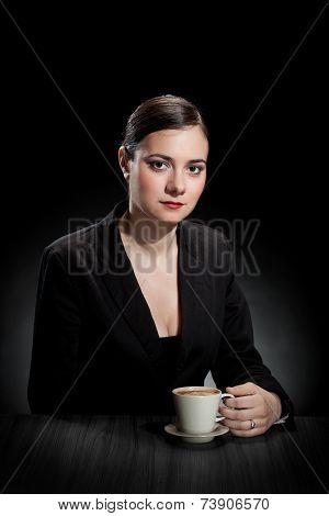 Beautiful Girl Enjoying A Cup Of Coffee