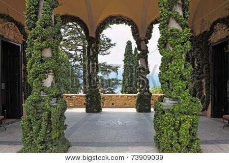 VILLA- MUSEUM BALBIANELLO, LAKE COMO, ITALY - SEPTEMBER 5, 2010: Magnificent park at the Italian villa-museum Balbyanello. Lake Como in the misty haze