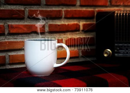 Coffee Cup And Reto Radio On  Table. Dark Brick Background.