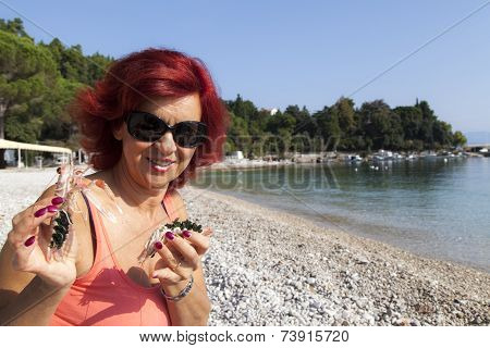 Pretty woman enjoying fresh Mediterranean scampi