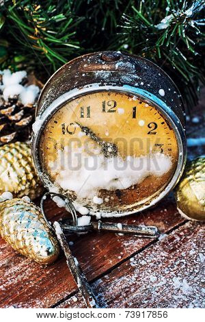 old broken alarm clock and Christmas decorations