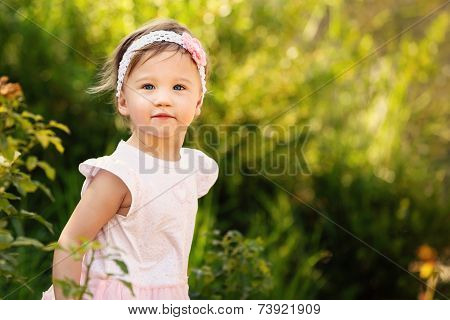 Beautiful Toddler A Garden Looking At Camera