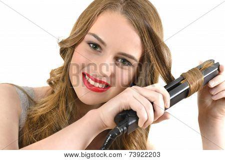 Woman Using Ceramic Hair Straightener