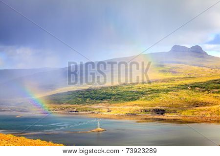 Rainbows over Westfjords in Iceland