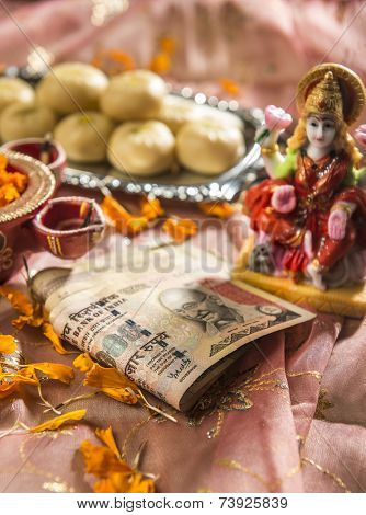 A bunch of thousand rupees indian note in Diwali Puja set up.