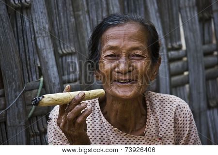 Smiling Asiatic Woman smoking