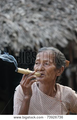 Asian Woman Smoking A Cigar