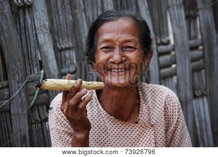 Smiling Asiatic Woman Smoking A Cigar Image Taken In A Little Village Near Pagan, In Myanmar Burma ,