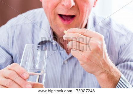 Old man taking overdoses medicaments at home