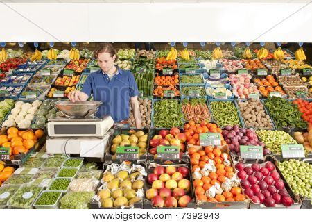 Greengrocer At Work