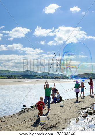 Making bubbles, Portmeirion beach