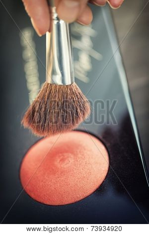 Close up view of different cosmetic brushes for makeup on a dressing table