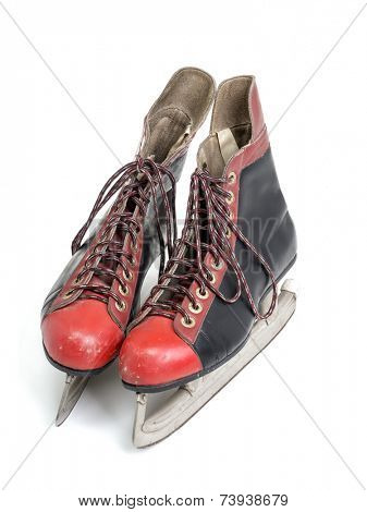 Old black and red hockey skates shot on white background