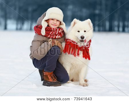 Happy Teenager Boy Walking With White Samoyed Dog