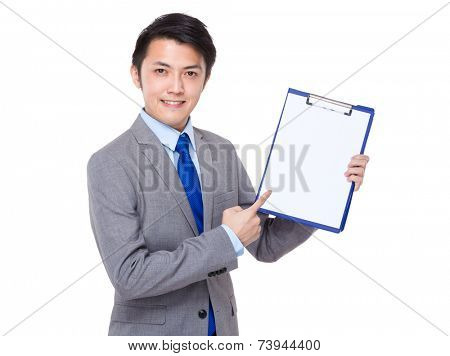Businessman show with white paper od clipboard