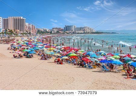 Beach with colorful umbrellas in Valencia.