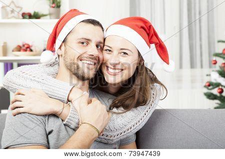Young Happy Couple Hug And Love Christmas