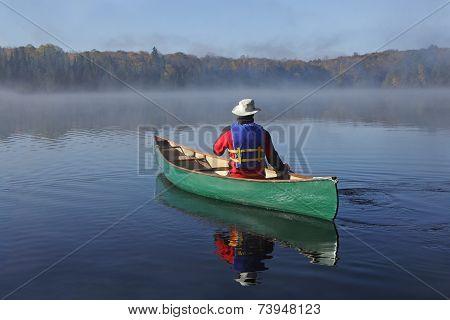 Canoeing On An Autumn Lake