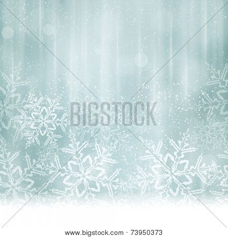 Abstract Christmas, winter background in shades of silver and desaturated blues tones. Light effects, snowfall big snow flakes give it a dreamy and festive feel. Space for your text.