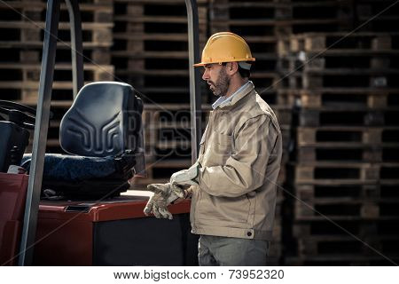 Warehouse worker with fork lift