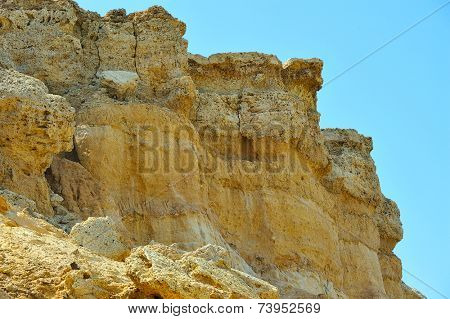 yellow cliff against blue sky