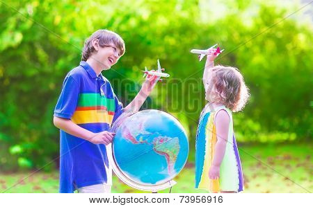 Kids Playing With Airplanes And Globe