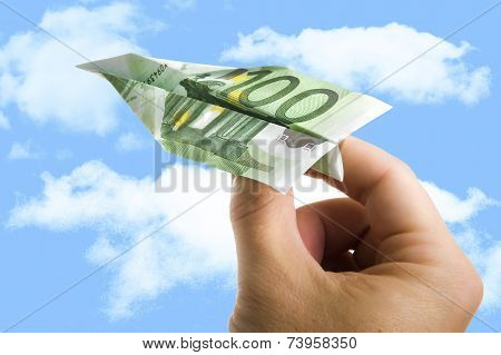 Hand Holding Banknote Paper Plane In Making Money And Financial Concept