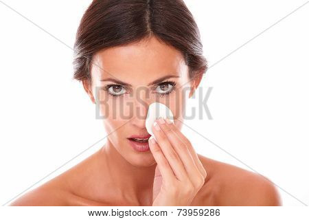 Mature Latin Woman Pampering Her Face