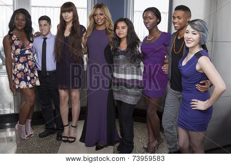 NEW YORK - OCT 16, 2014: Laverne Cox, actress in 'Orange Is The New Black' and cast members from her documentary 'The T Word' on the observation deck of the Empire State Building.