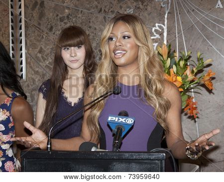 NEW YORK - OCT 16, 2014: Laverne Cox, actress in 'Orange Is The New Black' and cast members from her documentary 'The T Word' at the ceremony to light the Empire State Building purple.
