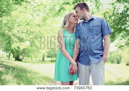 Lovely Tender Young Couple In Love Walking In Sunny Spring Park, Soft Colors
