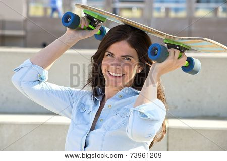 Goofy girl holding a skateboard on her head