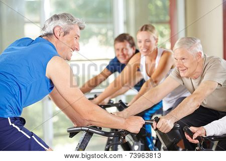 Senior people in class with trainer in a gym