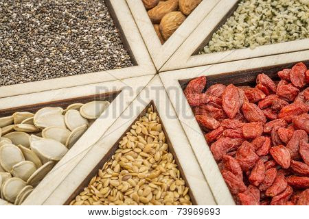 superfood abstract - dried goji berries, golden flax, pumpkin seeds, almonds, chia seeds and hemp seed hearts