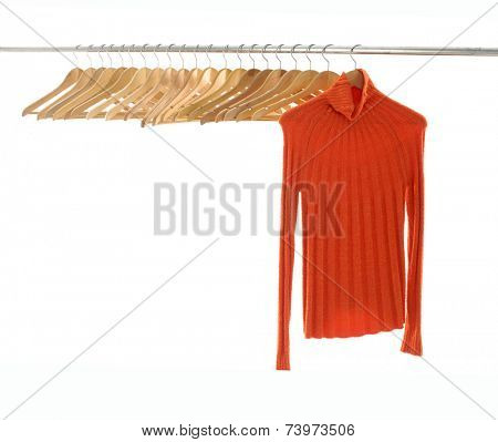 Row of Wooden hanger and clothing hanging a on display