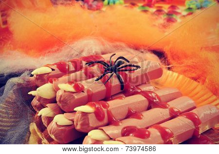 a pile of Halloween fingers with spiders and cobwebs of different colors in the background