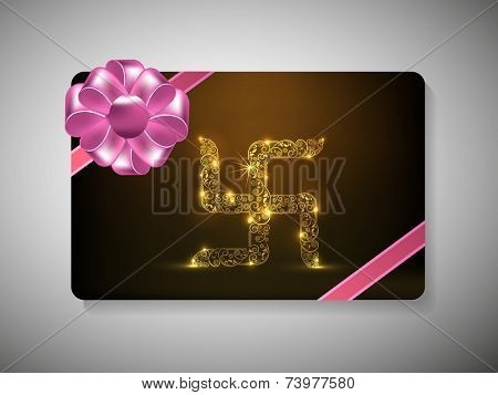 Diwali festival gift card with floral decorated shiny Swastika and ribbon decoration on brown background.